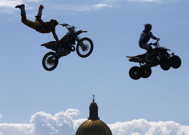 Participants perform stunts in front of St. Isaac's Cathedral during a festival of youth street culture in St. Petersburg, Russia, on June 28, 2014. (Photo by Alexander Demianchuk/Reuters)