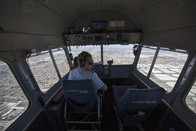 "Blimp Pilot Kristen Arambula flies the Goodyear blimp ""Spirit of America"" over Long Beach, California August 5, 2015. (Photo by Mike Blake/Reuters)"