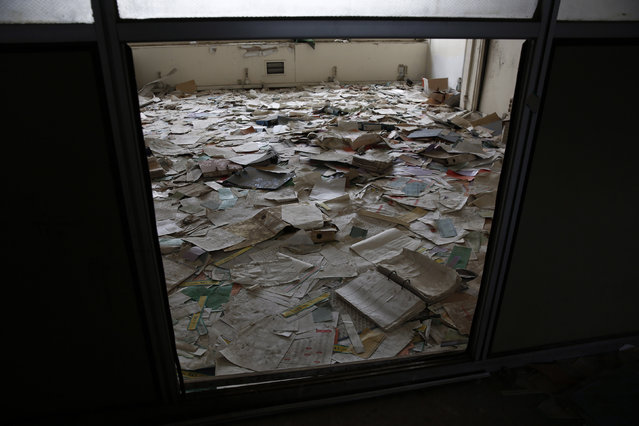 Documents are seen in an office at the former Athens International airport, Hellenikon June 17, 2014. (Photo by Yorgos Karahalis/Reuters)