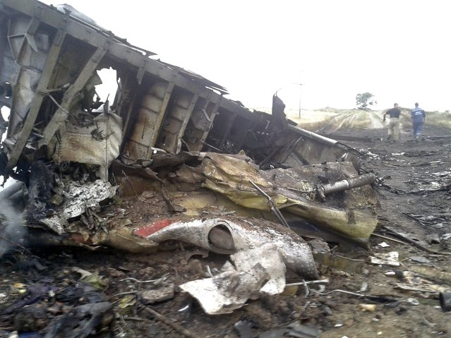The site of a Malaysia Airlines Boeing 777 plane crash is seen in the settlement of Grabovo in the Donetsk region, July 17, 2014. The Malaysian airliner MH-17 was shot down over eastern Ukraine by militants on Thursday, killing all 295 people aboard, a Ukrainian interior ministry official was quoted as saying by Interfax-Ukraine news agency. (Photo by Maxim Zmeyev/Reuters)