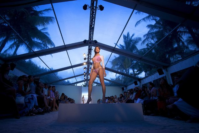 A model presents a creation of Belusso collection during Mercedes Benz Swim Fashion Week in Miami July 20, 2014. (Photo by Carlo Allegri/Reuters)