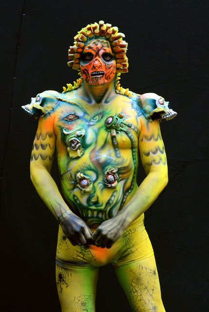 A model poses with her bodypainting designed by bodypainting artist Michael Muller from Germany, in the 2016 World Bodypainting Festival 2016 on July 3, 2016 in Poertschach am Woerthersee, Austria. (Photo by Didier Messens/Getty Images)