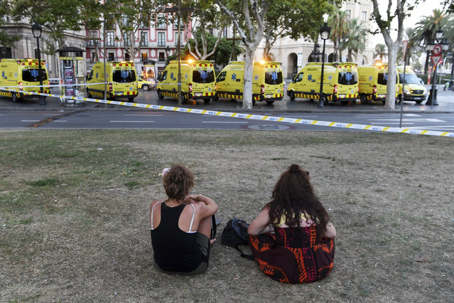People look toward the scene of a terrorist attack in the Las Ramblas area on August 17, 2017 in Barcelona, Spain. Officials say 13 people are confirmed dead and at least 50 injured after a van plowed into people in the Las Ramblas area of the city.  (Photo by David Ramos/Getty Images)
