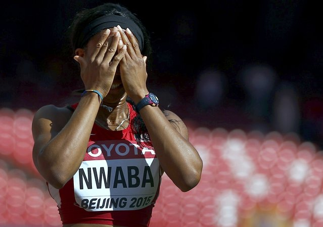 Barbara Nwaba of the U.S. reacts after a false start and disqualification in her 100m hurdles event of the women's heptathlon during the 15th IAAF World Championships at the National Stadium in Beijing, China August 22, 2015. (Photo by Kai Pfaffenbach/Reuters)