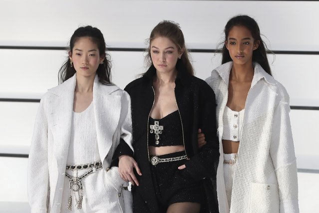 Model Gigi Hadid, center, walks with other models as they wear creations for the Chanel fashion collection during Women's fashion week Fall/Winter 2020/21 presented in Paris, Tuesday, March 3, 2020. (Photo by Thibault Camus/AP Photo)