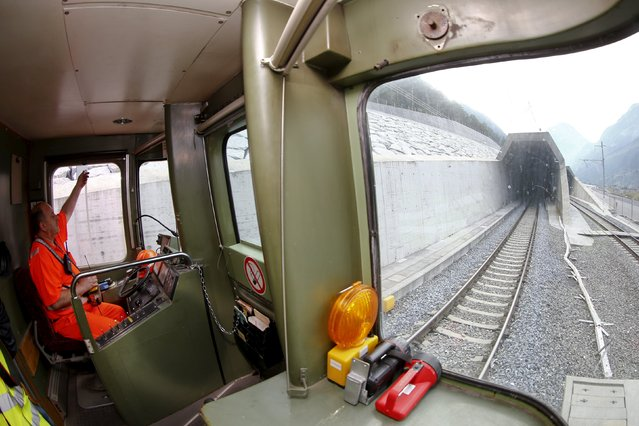 Engine driver Josef Kowatsch steers a train into the northern gate of the NEAT Gotthard Base Tunnel during a media visit near the town of Erstfeld August 24, 2015. (Photo by Arnd Wiegmann/Reuters)