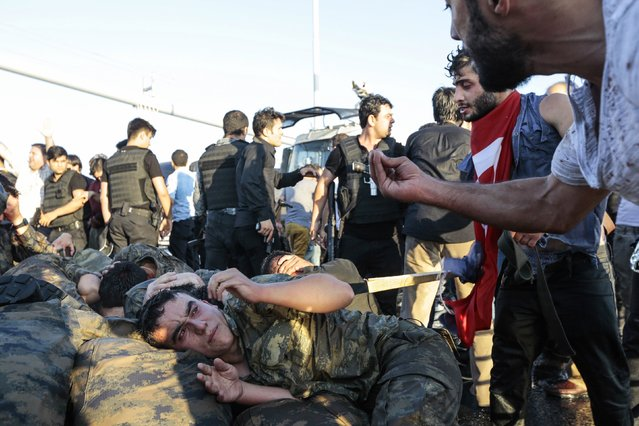 People shout at the soliders involved in the coup attempt who have surrendered  on Bosphorus bridge on July 16, 2016 in Instabul, Turkey. (Photo by Gokhan Tan/Getty Images)