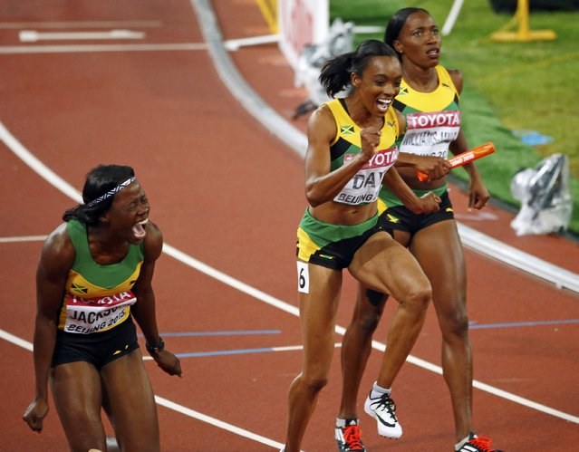 Shericka Jackson of Jamaica (L) and teammates Christine Day (C) and Novlene Williams-Mills celebrate after crossing the finish line in the women's 4 x 400 metres relay final during the 15th IAAF World Championships at the National Stadium in Beijing, China, August 30, 2015. (Photo by David Gray/Reuters)