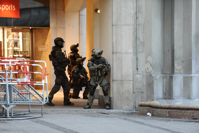 Heavily armed police forces operate at Karlsplatz (Stachus) square after a shooting in the Olympia shopping centre was reported in Munich, southern Germany, Friday, July 22, 2016. (Photo by Andreas Gebert/DPA via AP Photo)