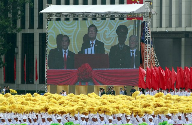 Vietnam's President Truong Tan Sang (C) is seen on screen while speaking at a parade marking their 70th National Day at Ba Dinh square in Hanoi, Vietnam September 2, 2015. (Photo by Reuters/Kham)
