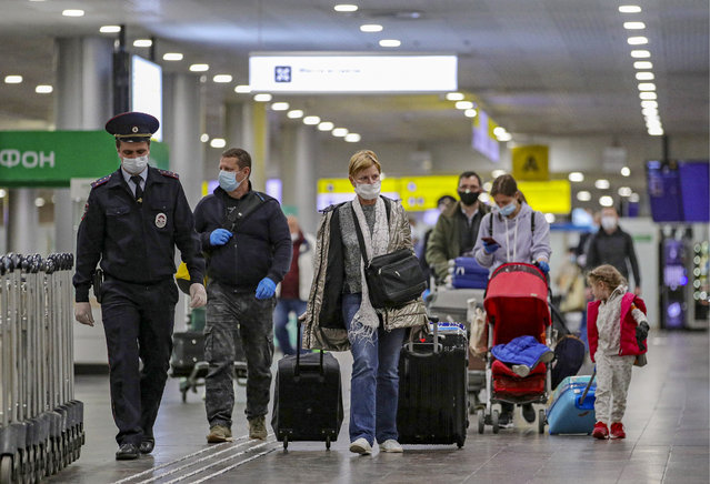 Passengers of an Aeroflot charter flight for Russian evacuees from Phuket arrive at Sheremetyevo International Airport in Moscow Region, Russia on April 11, 2020. On March 27, the Russian government ordered an international flight ban amid the ongoing COVID-19 pandemic, with the exception of charter flights to evacuate Russian citizens from abroad. (Photo by Sergei Bobylev/TASS)