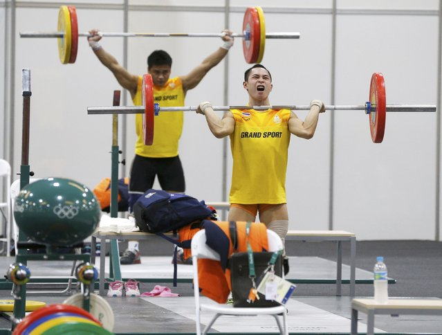2016 Rio Olympics, Copacabana on July 29, 2016. Weightlifters from Thailand practice. (Photo by Athit Perawongmetha/Reuters)