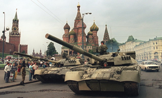 A picture taken on August 19, 1991 shows Soviet Army tanks parked near Spassky gate (L), an entrance to the Kremlin and Basil's Cathedral (C) in Moscow's Red Square after a coup toppled Soviet President Mikhail Gorbachev. Russia marks on August 19-22, 2011, the 20th anniversary of the abortive 1991 coup against then Soviet president Mikhail Gorbachev. Tanks rolled through Moscow towards the Russian White House, where Boris Yeltsin, leader of the Soviet-era Russian republic at the time, gathered his supporters after denouncing the coup from the roof of a tank, which resulted later in the collapse of the Soviet empire. (Photo by Dima Tanin/AFP Photo)
