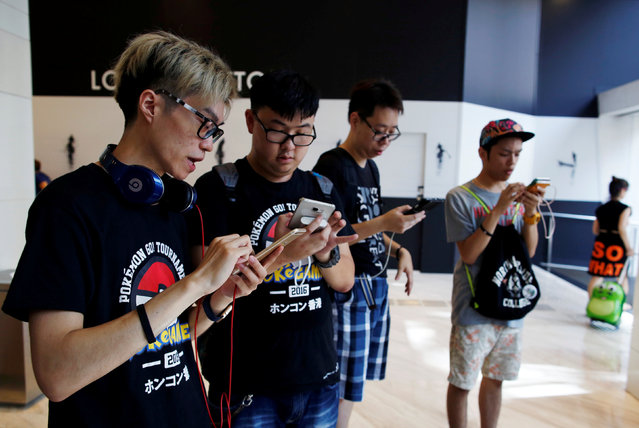 "Participants take part in the world's first ""Pokemon Go"" competition in Hong Kong, China, August 6, 2016. (Photo by Tyrone Siu/Reuters)"