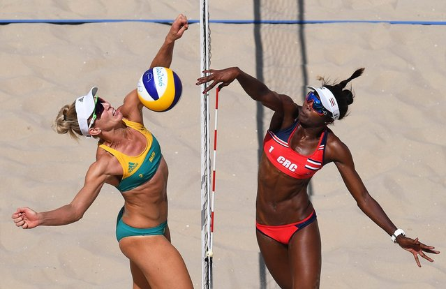 Louise Bawden (L) of Australia in action against Karen Cope Charles (R) of Costa Rica during the women's Beach Volleyball Preliminary round matches of the Rio 2016 Olympic Games at the Beach Volleyball Arena on Copacabana Beach in Rio de Janeiro, Brazil, 06 August 2016. (Photo by Dean Lewins/EPA)