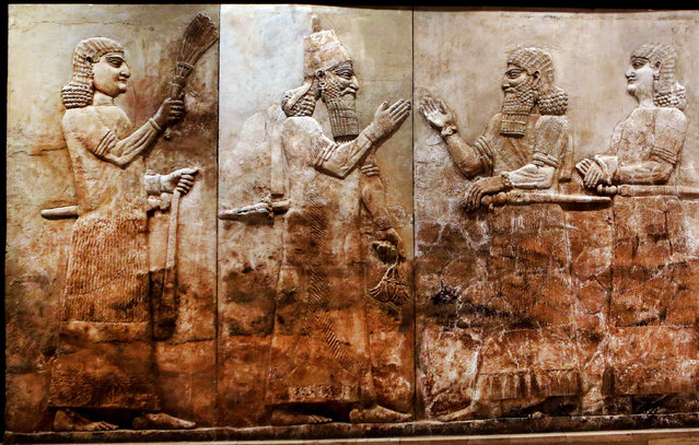 This Monday, September 15, 2014 photo shows, bas-relief displayed at the Iraqi National Museum in Baghdad. For more than 5,000 years, numerous civilizations have left their mark on upper Mesopotamia – from Assyrians and Akkadians to Babylonians and Romans. Their ancient, buried cities, palaces and temples packed with monumental art are scattered across what is now northern Iraq and eastern Syria. (Photo by Hadi Mizban/AP Photo)