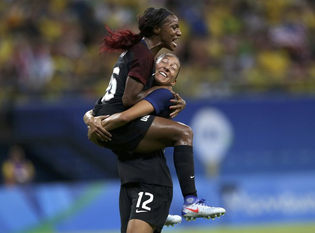 2016 Rio Olympics, Soccer, Preliminary, Women's First Round, Group G Colombia vs USA, Amazonia Stadium, Manaus, Brazil on August 9, 2016. Crystal Dunn (USA) of USA celebrates a goal with Christen Press (USA) of USA. (Photo by Bruno Kelly/Reuters)
