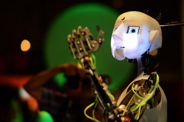 A robot gestures at the Ideen Park fair in Essen, Germany, on August 13, 2012. The fair is organized for children and young adults by the German steel company ThyssenKrupp AG to inspire their spirit of research and to promote careers in science and technology. (Photo by Patrik Stollarz/AFP Photo)