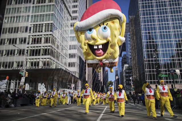 The SpongeBob SquarePants float moves down Sixth Avenue during the Thanksgiving Day parade in New York on November 23, 2017. (Photo by Mary Altaffer/AP Photo)