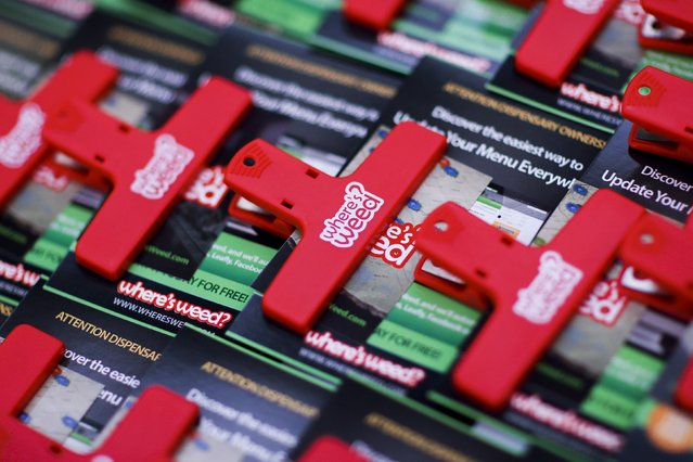Information of where to buy weed is seen attached to clips during the International Cannabis Association Convention in New York, October 12, 2014. (Photo by Eduardo Munoz/Reuters)