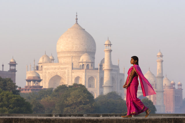 #5. India, Total GDP: USD 2.264 trillion (2016). Contribution of Travel and Tourism to GDP: 9.6%. Here: Young Indian woman walking near Taj Mahal in early morning light. (Photo by Adrian Pope/Getty Images)