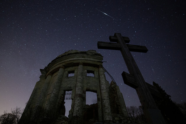 Stars are seen in the night sky during the Lyrid Meteor Shower over the ruins of Saint Trinity church in Leningrad Region, Russia on April 22, 2020. (Photo by Anton Vaganov/Reuters)