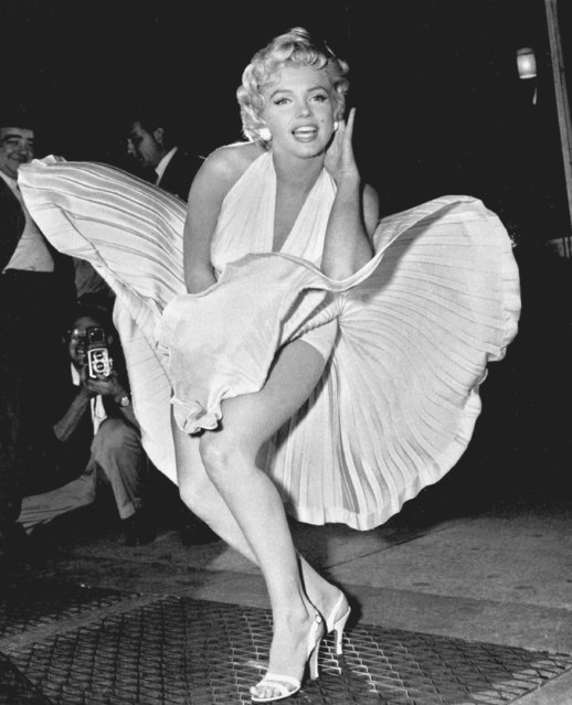 """Marilyn Monroe poses over the updraft of New York subway grating while in character for the filming of """"The Seven Year Itch"""" in Manhattan on September 15, 1954.  The former Norma Jean Baker modeled and starred in 28 movies grossing $200 million. Sensual and seductive, but with an air of innocence, Monroe became one of the world's most adored s*x symbols. She died alone by suicide, at age 36 in her Hollywood bungalow. (Photo by Matty Zimmerman/AP Photo)"""