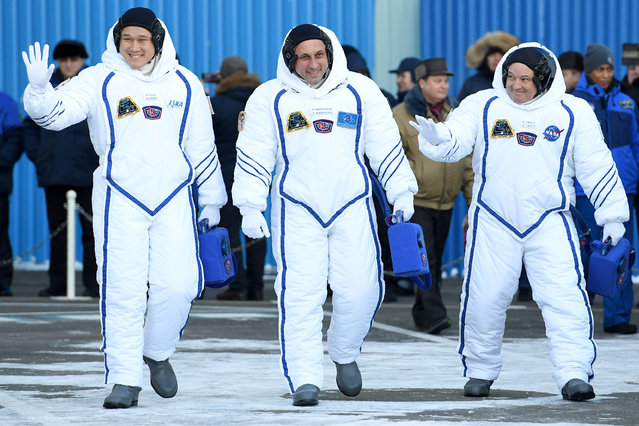 Members of the International Space Station expedition 54/55, Roscosmos cosmonaut Anton Shkaplerov (C), NASA astronaut Scott Tingle (R) and Norishige Kanai (L) of the Japan Aerospace Exploration Agency (JAXA) during the send-off ceremony after checking their space suits before the launch of the Soyuz MS-07 spacecraft at the Baikonur cosmodrome, in Kazakhstan, 17 December 2017. (Photo by Kirill Kudryavtsev/Reuters)