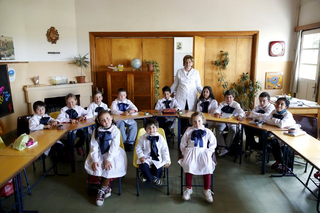Teacher Ana Dorrego poses with students of the rural school Agustin Ferreira on the outskirts of Minas city, Uruguay, September 15, 2015. (Photo by Andres Stapff/Reuters)