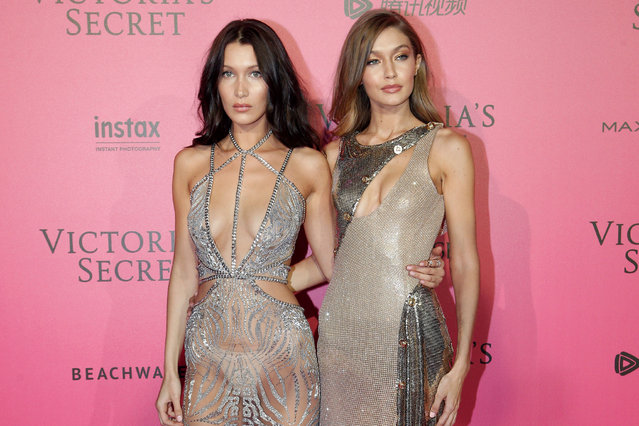 Models Bella Hadid, left, and Gigi Hadid pose during the after party photocall after the Victoria's Secret fashion show Wednesday, November 30, 2016 in Paris. The Victoria's Secret fashion show took place in Paris with performances by Lady Gaga and Bruno Mars. (AP Photo/Thibault Camus)