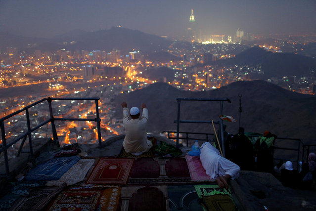 A pilgrim prays at Mount Al-Noor, where Muslims believe Prophet Mohammad received the first words of the Koran through Gabriel in the Hera cave, ahead of the annual haj pilgrimage in the holy city of Mecca, Saudi Arabia September 7, 2016. (Photo by Ahmed Jadallah/Reuters)