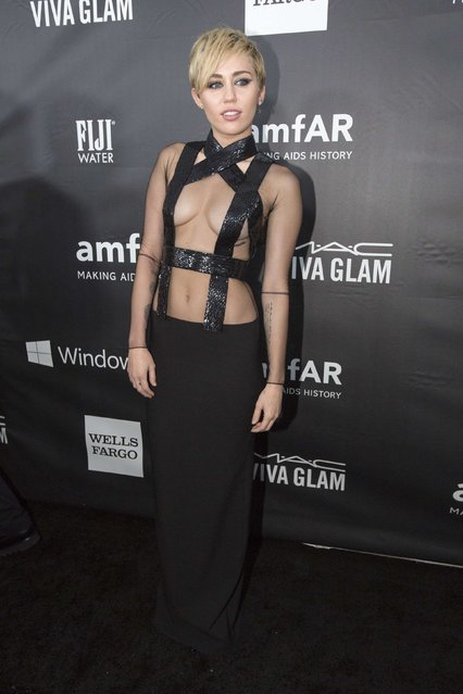 Singer Miley Cyrus poses at the amfAR's Fifth Annual Inspiration Gala in Los Angeles, California October 29, 2014. (Photo by Mario Anzuoni/Reuters)
