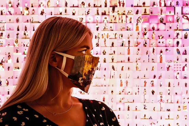 "A visitor views a work titled ""Murmurations #23: 10,000 selfies (with a pink wall in Los Angeles)"" by artist Stephanie Potter Corwin, that forms part of the Aesthetica Art Prize exhibition on show at York Art Gallery in Yorkshire on August 13, 2020. (Photo by Danny Lawson/PA Images via Getty Images)"