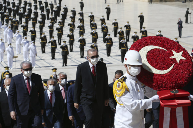 Turkey's President Recep Erdogan, center, follows a military honour guard during a ceremony at the mausoleum of Mustafa Kemal Ataturk, founder of modern Turkey, in Ankara, Turkey, Sunday, August 30, 2020. Turkey marked the 98th anniversary of the decisive War of Independence battle against Greek forces Sunday as the threat of a new conflict with Athens looms in the eastern Mediterranean.(Photo by Turkish Presidency via AP Photo/Pool)