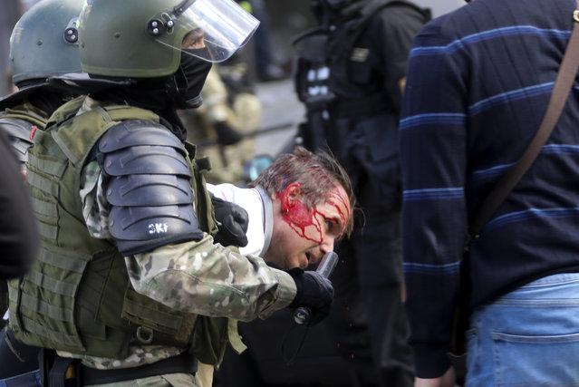 Riot police officers detain a protester during a Belarusian opposition supporters' rally protesting the official presidential election results in Minsk, Belarus, Sunday, September 13, 2020. (Photo by AP Photo/Stringer)