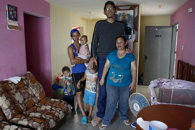 Jeison Rodriguez (C), 19, the living person with the largest feet, poses for a picture with his mother Amalia (R), his brother Erick, 21, and his nephews at their house in Maracay, Venezuela, October 14, 2015. (Photo by Carlos Garcia Rawlins/Reuters)