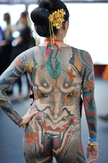 A woman with a Japanese style full back body tattoo at the 12th London International Tattoo Convention, which opened today in Tobacco Dock, east London on September 23, 2016. (Photo by Michael Preston/Alamy Live News)
