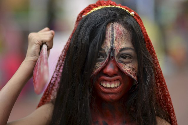 A girl poses in her costume during a Halloween party at a mall in Quezon city, Metro Manila October 24, 2015. (Photo by Ezra Acayan/Reuters)