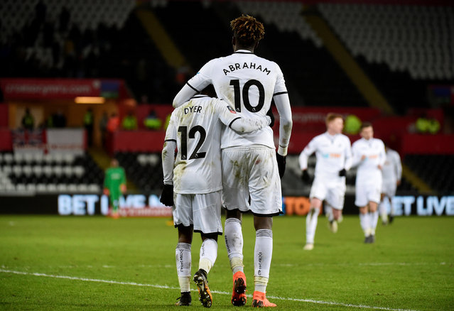 Swansea City' s English midfielder Nathan Dyer (L) celebrates with Swansea City' s English striker Tammy Abraham scoring the team' s second goal during the English FA Cup 5th round replay football match between Swansea City and Sheffield Wednesday at The Liberty Stadium in Swansea, south Wales on February 27, 2018. (Photo by Rebecca Naden/Reuters)