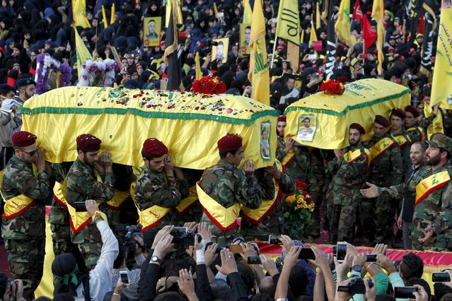 Lebanon's Hezbollah members, supporters and relatives carry the coffins of three Hezbollah fighters who were killed while fighting alongside Syrian army forces in Syria during their funeral in Nabatieh town, southern Lebanon October 27, 2015. (Photo by Ali Hashisho/Reuters)
