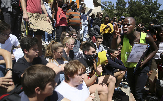 """A student supporting the """"Fees Must Fall"""" movement, right, shouts at students who want to return to class at the University of the Witwatersrand in Johannesburg on Wednesday, October 5, 2016. In a racially charged scene, a mostly black group of student protesters confronted white students who want protests for free education to stop so they can complete the academic year. (Photo by AP Photo)"""