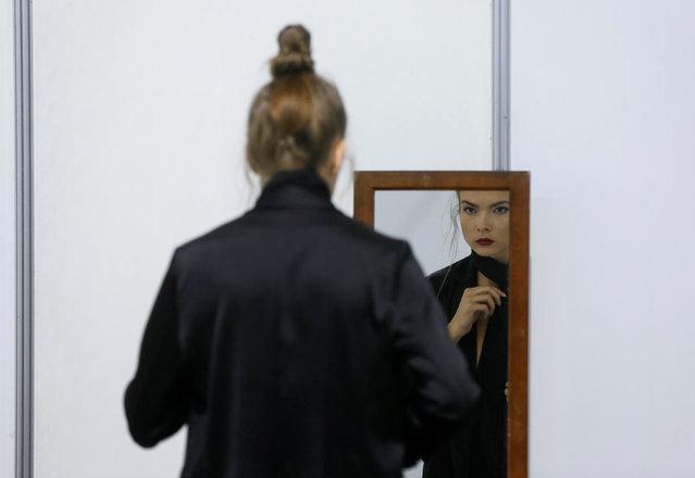 A model waits backstage during Ukrainian Fashion Week in Kiev, Ukraine, October 13, 2016. (Photo by Valentyn Ogirenko/Reuters)