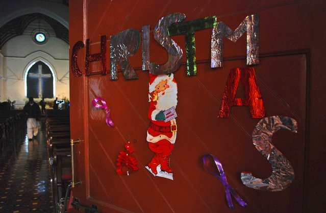 Christmas decorations are seen on a door at the St Johns Cathedral Church, on Christmas eve in Peshawar December 24, 2014. (Photo by Khuram Parvez/Reuters)