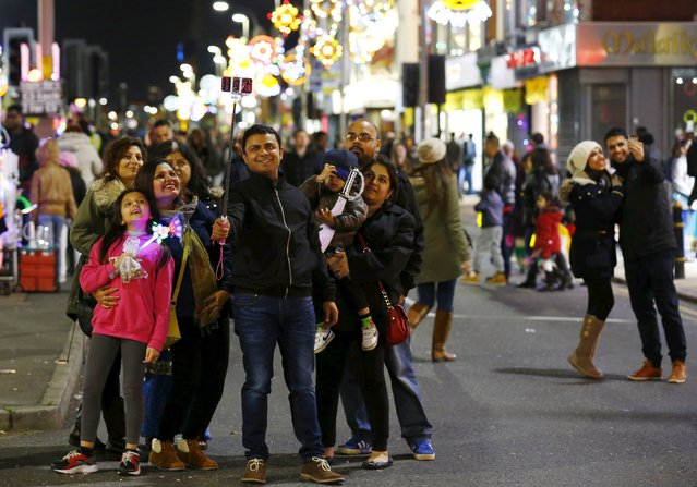A family pose for a selfie during Diwali celebrations in Leicester, Britain November 11, 2015. (Photo by Darren Staples/Reuters)