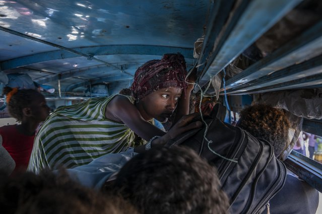 Tigray refugees who fled the conflict in the Ethiopia's Tigray ride a bus going to the Village 8 temporary shelter, near the Sudan-Ethiopia border, in Hamdayet, eastern Sudan, Tuesday, December 1, 2020. (Photo by Nariman El-Mofty/AP Photo)
