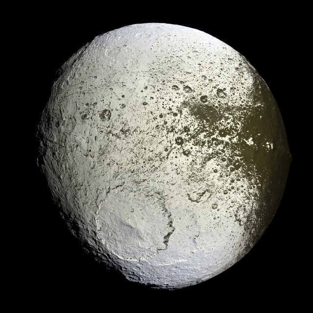 The planet Saturn's moon Iapetus is shown in the first high-resolution image taken September 10, 2007 by NASA's Cassini spacecraft. (Photo by Reuters/NASA/JPL/Space Science Institute)