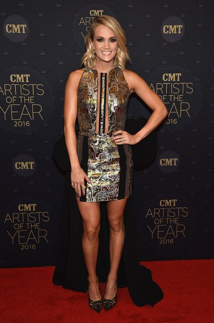 Honoree Carrie Underwood arrives on the red carpet at CMT Artists of the Year 2016 on October 19, 2016 in Nashville, Tennessee. (Photo by John Shearer/Getty Images for CMT)