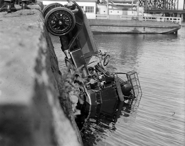 Truck goes into harbor, 1930. (Photo by Leslie Jones)