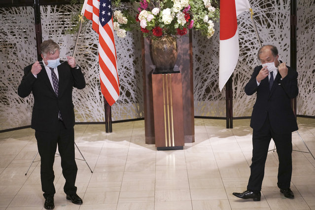 U.S. Special Representative for North Korea Stephen Biegun, left, and Japanese Vice Foreign Minister Takeo Akiba, right, take off their protective masks for a photo session prior to their bilateral meeting at Iikura Guest House Thursday, July 9, 2020, in Tokyo. (Photo by Eugene Hoshiko/AP Photo/Pool)