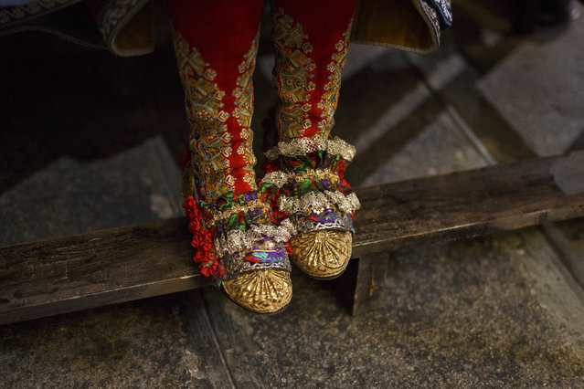 "A woman wears the traditional costume of ""Lagarterana"" (shoe detail) as she attends a mass in the church before the start of the Corpus Christi procession on June 3, 2018 in Lagartera, in Toledo province, Spain. (Photo by Pablo Blazquez Dominguez/Getty Images)"